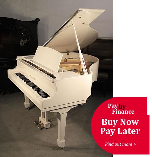 White, Steinhoven Model 148 baby grand Piano for sale.