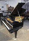 Piano for sale. Antique 1901, Steinway Model A grand piano for sale with a black case and spade legs.
