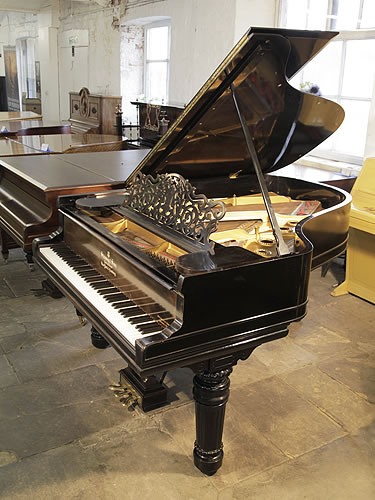 An 1898, Steinway Model A Grand piano for sale with a black case, filigree music desk and fluted, barrel legs