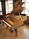Piano for sale. A 1900 Steinway Model A grand piano with a walnut case, filigree music desk and fluted, barrel legs