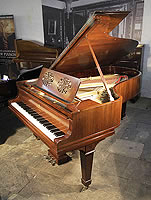 A 1919, Steinway Model B grand piano for sale with a rosewood case, spade legs and cut-out music desk in a floral design