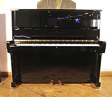 A 1995, Steinway Model K upright piano with a black case and brass fittings