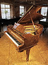 Piano for sale. A 1938, Steinway Model O grand piano with a burr walnut case and spade legs