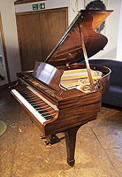 A rebuilt, 1937, Steinway Model S baby grand piano for sale with a mahogany case and spade legs