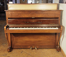 A 1951, Steinway Model Z upright piano with a mirrored, walnut case and cabriole legs
