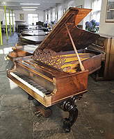 An antique, Steinway Style 2 grand piano with a rosewood case, filigree music desk and ornately carved, scroll foot legs and lyre