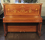 A 1906, Steinway Vertegrand Upright Piano For Sale with a Fiddleback Mahogany Case Inlaid with Swags and Scrolling Foliage.
