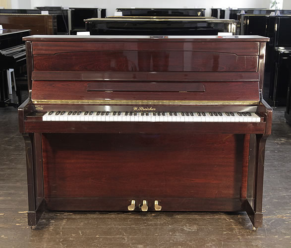 A Streicher upright piano with a mahogany case .