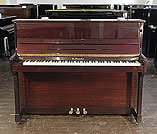 Piano for sale. A Streicher upright piano with a mahogany case