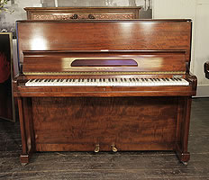 A Welmar upright piano with a flame mahogany case