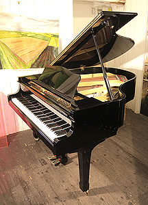 A Yamaha G2 grand piano for sale with a black case and spade legs