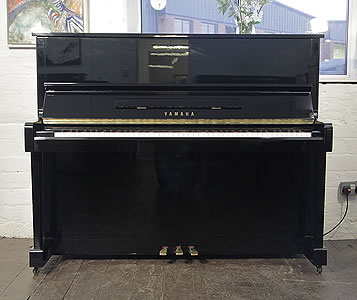 A reconditioned,  1988, Yamaha MC10Bl Upright Piano For Sale with a Black Case and Brass Fittings