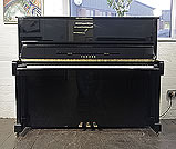 Piano for sale. A 1988, Yamaha MC10Bl Upright Piano For Sale with a Black Case and Brass Fittings