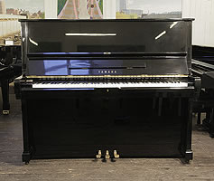 A 1973, Yamaha U2 upright piano with a black case and polyester finish