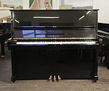 Piano for sale. A secondhand, Yamaha U2 upright piano with a black case and polyester finish.