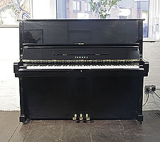 A 1980, Yamaha U2 upright piano with a black case and polyester finish