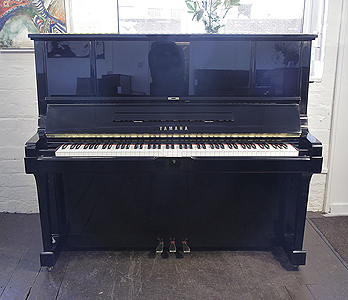 A 1988, Yamaha UX-3 upright piano with a black case and polyester finish Piano has an eighty-eight note keyboard and three pedals.