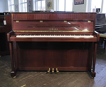 A Yamaha V114N upright piano with a mahogany case and polyester finish