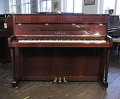 A Yamaha V114N upright piano with a mahogany case and polyester finish.