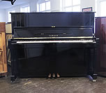 Piano for sale.  A 1981, Yamaha YUS upright piano with a black case and polyester finish.