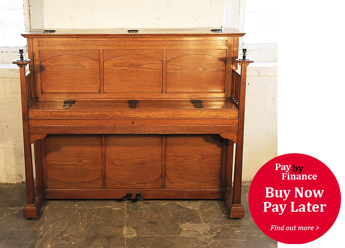 A 1903, Arts and Crafts style, Bluthner upright piano with an oak case and ornate hinges
