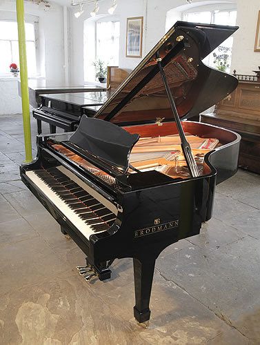 Piano for sale. A Brodmann BG187 grand piano for sale with a black case and spade legs