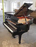 A Brodmann BG187 grand piano for sale with a black case and spade legs