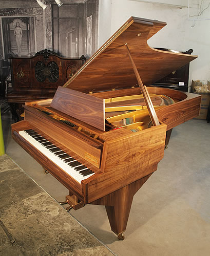 Piano for sale. A 1951, Challen concert grand piano with an american walnut case
