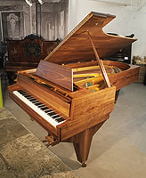 A 1951, Challen concert grand piano with an ameican walnut case