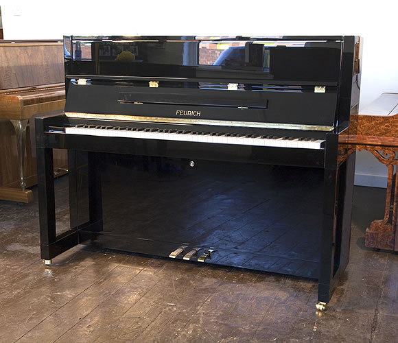 Brand New, Feurich Model 115 upright Piano for sale with a black case.