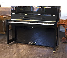 A Brand new, Bauhaus style, Feurich Model 115 Premiere upright piano with a black case and polyester finish