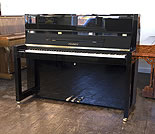Piano for sale. A Brand new, Bauhaus style, Feurich Model 115 Premiere upright piano with a black case and polyester finish.