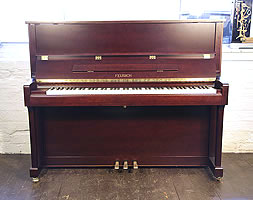 A Brand new, Feurich Model 122 upright piano with a satin, mahogany case and brass fittings