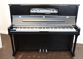 A Brand New Feurich Model 123 upright piano with a satin, black case, LED Lighting and chrome fittings. Piano features a high speed KAMM action that allows for extremely fast repetition