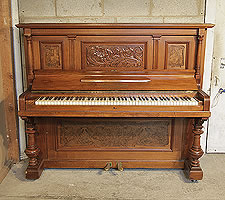 A 1903, Feurich upright piano with a walnut case, and Art Nouveau style carved front panel and cup and cover legs