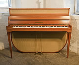 Piano for sale. A 1955, Mid Century Modern style, Grotrian-Steinweg model 110 upright piano with a walnut case and fabric panels.