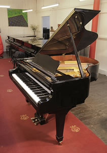 A 2011, Hoffmann V158 Baby Grand Piano For Sale with a Black Case Piano has an eighty-eight note keyboard and a three-pedal lyre.