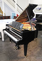 A 2017, Kawai GE20 baby grand piano for sale with a black case and square, tapered legs.