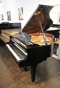 A Kawai KF-1 baby grand piano for sale with a black case and square, tapered legs