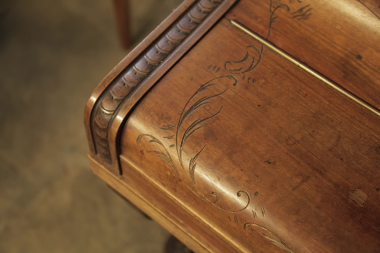 Lamberger & Gloss piano cheek featuring carved strapwork and etched detail