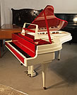 Piano for sale. A 1959, Rippen grand piano with a contrasting cherry polyester and painted aluminium case. This Rippen piano has a beautiful slimline outline and minimal openwork music desk