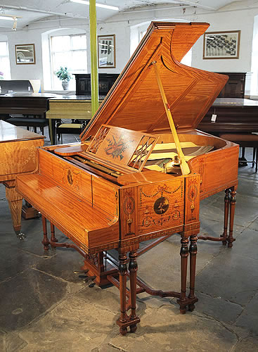 A 1908, Steinway grand piano for sale with a satinwood case, hand-painted with Berainesque decoration. Designed and made by Waring & Gillow