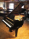 Piano for sale. A 1925, Steinway Model B grand piano with a black case and spade legs