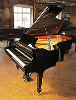 A 1999, Steinway Model B grand piano for sale with a black case and spade legs