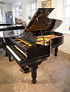 Piano for sale. An 1893, Steinway Model B grand piano with a black case, filigree music desk and fluted, barrel legs