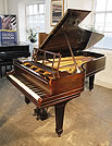 Piano for sale. An 1883, Steinway Model C grand piano with a rosewood case, openwork music desk and spade legs