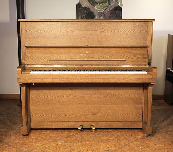 | A 1985, Steinway Model K Upright Piano For Sale with a Polished, Oak Case