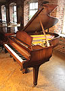 Piano for sale. A 1939, Steinway Model O grand piano for sale with a polished, walnut case and spade legs