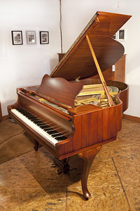 A stunning, 1957, Steinway Model S baby grand piano for sale with a walnut case and cabriole legs. Piano has an eighty-eight note keyboard and a two-pedal lyre.