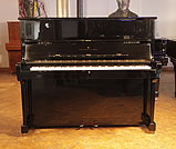Piano for sale. A 1985, Steinway Model V upright piano with a black case and brass fittings
